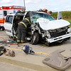 Kokomo firefighters work to free the passenger of a van that seriously injured at Ind. 26 and 250 East on Saturday afternoon Sept. 28, 2019. The guy was flown via helicopter to the hospital. The other injured were taken to Community Howard Regional Health. <br /> Tim Bath | Kokomo Tribune