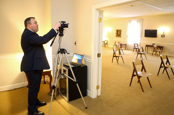 Funeral director Brian Riffe sets up webscasting for an upcoming funeral at Shirley & Stout Funeral Home on Lincoln Road on Wednesday, April 1, 2020. The chairs for the family have also had to be spaced apart.<br /> Kelly Lafferty Gerber   Kokomo Tribune