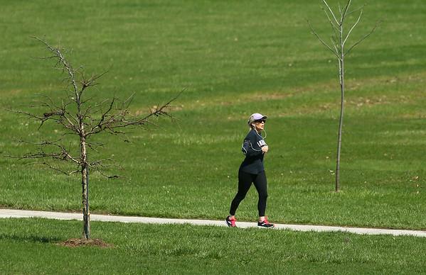People took advantage of the sunny 60 degree weather at Jackson Morrow Park on Thursday, April 2, 2020.<br /> Kelly Lafferty Gerber | Kokomo Tribune