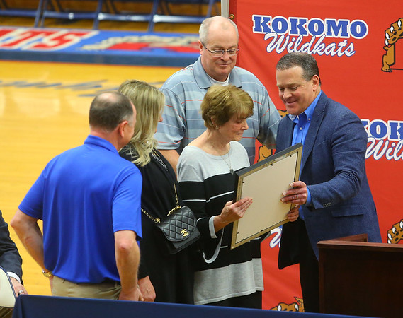 "Kokomo mayor Tyler Moore, right, shares a proclamation with Jimmy Rayl's family as former basketball teammates, coaches, friends and family joined together for a special ceremony inside Memorial Gym on Thursday, Feb. 6, when the City of Kokomo announced the honorary renaming of West Superior Street leading to Memorial Gym ""Jimmy Rayl Boulevard.""<br /> Kelly Lafferty Gerber 