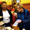 Chef Essie Foster watches as Peggy Hobson tries a sample of her chocolate during the Black History Month African-American Artisan Fair at the Elliott House on Thursday, Feb. 27, 2020.<br /> Kelly Lafferty Gerber | Kokomo Tribune