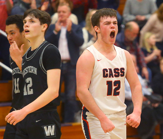 2-14-20<br /> Cass vs Western boys basketball<br /> Cass' Isaac Chambers celebrates after their win in overtime.<br /> Kelly Lafferty Gerber | Kokomo Tribune
