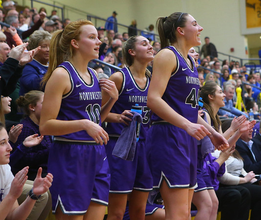 2-15-20<br /> Northwestern vs Homestead girls basketball regional championship<br /> Klair Merrell, Kendall Bostic and Madison Layden cheer from the sidelines in the last seconds of the game.<br /> Kelly Lafferty Gerber | Kokomo Tribune
