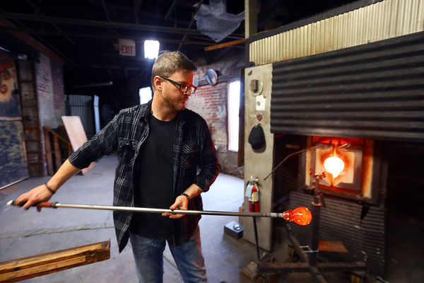 Options for storing or displaying ashes from loved ones or pets at Kokomo Opalescent Glass on February 3, 2020. Jeff Simmons produces a paper weight with creamation ashes in it.<br /> Tim Bath | Kokomo Tribune