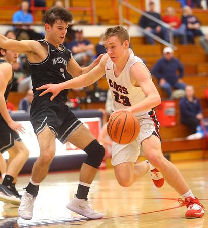 2-14-20<br /> Cass vs Western boys basketball<br /> Cass' Tyson Johnson takes the ball down the court.<br /> Kelly Lafferty Gerber | Kokomo Tribune