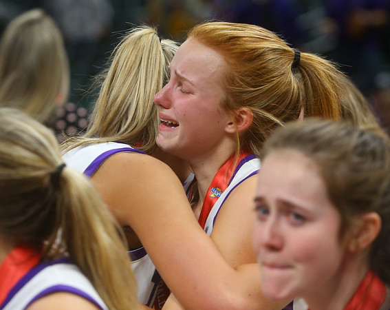 2-29-20<br /> Northwestern vs Lawrence North girls basketball state final<br /> Klair Merrell hugs her teammate Madison Layden after Northwestern loses to Lawrence North 59-56.<br /> Kelly Lafferty Gerber | Kokomo Tribune
