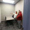 Annie Gegner, left, and Debbie Kimbler look to see if they can spot shadows behind the two-way mirror in the interview room on the administration side of the new Tipton jail during a public open house on Thursday, Feb. 20, 2020.<br /> Kelly Lafferty Gerber | Kokomo Tribune