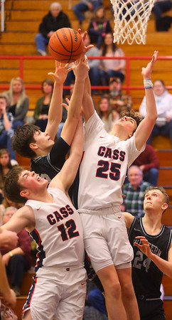 2-14-20<br /> Cass vs Western boys basketball<br /> Cass' Isaac Chambers, left, and Tyson Good, right, go up for a rebound alongside Western's Dylan Bryant.<br /> Kelly Lafferty Gerber | Kokomo Tribune
