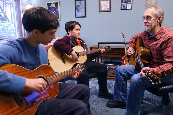 Gary Rhum works with and jams with his sons Levi, 12, and Eberson, 10, on February 25, 2020.<br /> Tim Bath   Kokomo Tribune
