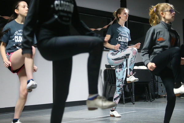 25-year-old Kara Murray, center, learns a new clogging routine alongside 13-year-old Ellie Mae Catron, 15-year-old Katie Waitt, and 10-year-old Emmara Gibbs during a Split Sole Clogging Connection class on Saturday, Feb. 7, 2020.<br /> Kelly Lafferty Gerber | Kokomo Tribune