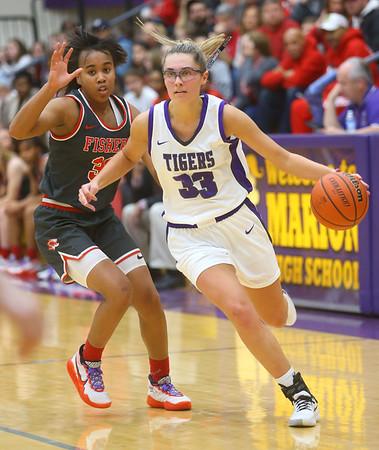 2-15-20<br /> Northwestern vs Fishers girls basketball regional semi-final<br /> Madison Layden takes the ball down the court.<br /> Kelly Lafferty Gerber | Kokomo Tribune