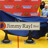 "Jimmy Rayl's family, along with Mayor Tyler Moore, unveil the Jimmy Rayl Boulevard sign after former basketball teammates, coaches, friends and family shared memories of the Indiana basketball legend during a special ceremony inside Memorial Gym on Thursday, Feb. 6. The City of Kokomo announced the honorary renaming of West Superior Street leading to Memorial Gym ""Jimmy Rayl Boulevard.""<br /> Kelly Lafferty Gerber 