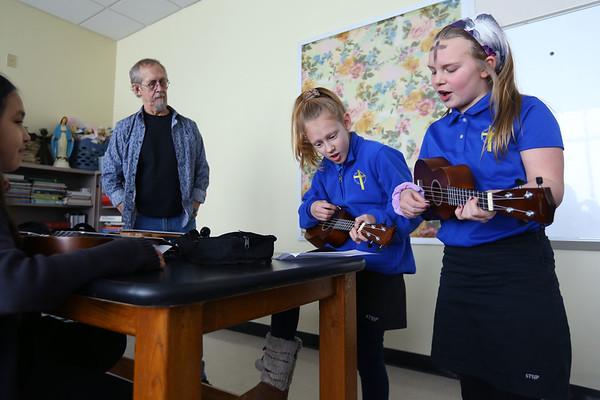 Gary Rhum teaches a ukulele class at Sts. Joan of Arc and Patrick School on February 26, 2020.<br /> Tim Bath | Kokomo Tribune