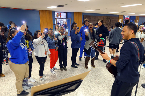 Kokomo High School students hold up lights with Chris Thomas dressed as Sam Cook performs during lunch hour for Black History Month on February 26, 2020.<br /> Tim Bath | Kokomo Tribune