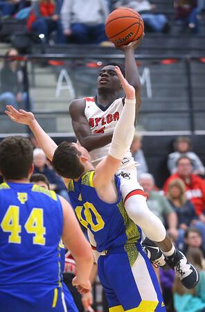2-28-20<br /> Taylor vs Tri-Central boys basketball<br /> Taylor's Toric Spires shoots.<br /> Kelly Lafferty Gerber | Kokomo Tribune