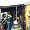Kokomo firefighters work a mobile home fire at 2900 North Apperson Way lot 281 suspected to have started by a cigarette  on February 23, 2020.<br /> Tim Bath   Kokomo Tribune