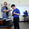 Gary Rhum plays along with Nick Seybert while teaching a ukulele class at Sts. Joan of Arc and Patrick School on February 26, 2020.<br /> Tim Bath | Kokomo Tribune