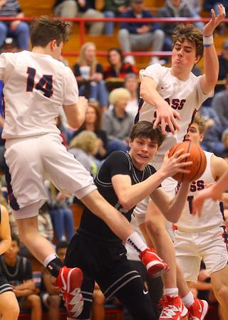 2-14-20<br /> Cass vs Western boys basketball<br /> Cass' Garrett McLeland and Tyson Good put up defense on Western's Dylan Bryant.<br /> Kelly Lafferty Gerber   Kokomo Tribune