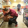 Maconaquah High School freshman Jonah Spangler, 14, checks on the rabbits in the Brave Bunny Rabbitry on Feb. 26, 2020.<br /> Kelly Lafferty Gerber | Kokomo Tribune