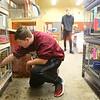 Maconaquah High School freshman Jonah Spangler, 14, checks on the rabbits in the Brave Bunny Rabbitry on Feb. 26, 2020.<br /> Kelly Lafferty Gerber | Kokomo Tribune