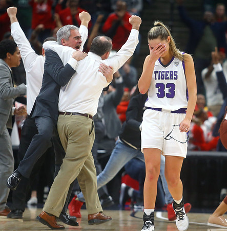 2-29-20<br /> Northwestern vs Lawrence North girls basketball state finals<br /> Madison Layden covers her face as she walks off the court after Lawrence North beat Northwestern 59-56.<br /> Kelly Lafferty Gerber | Kokomo Tribune