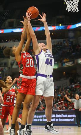 2-29-20<br /> Northwestern vs Lawrence North girls basketball state finals<br /> Kendall Bostic goes up for a rebound.<br /> Kelly Lafferty Gerber | Kokomo Tribune