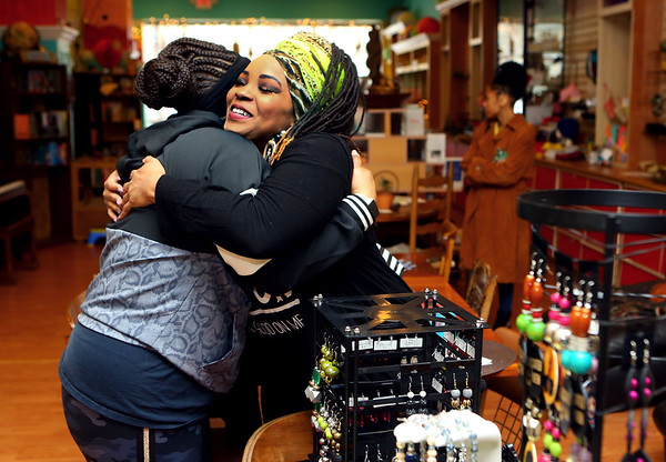 Christina Vaughn, right, gives Rhonda Hill a hug after Hill shops EQuilibrium, Vaughn's handmade jewelry business during Black Wall Street Market, part of BlacKokomo History Fest at Beyond Borders Bookstore on Saturday, Feb. 8, 2020.<br /> Kelly Lafferty Gerber | Kokomo Tribune