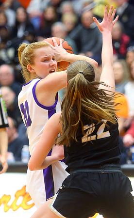 2-22-20<br /> Northwestern vs Penn girls basketball semistate<br /> NW's Klair Merrell looks for a pass over Penn's Reganne Pate.<br /> Kelly Lafferty Gerber | Kokomo Tribune
