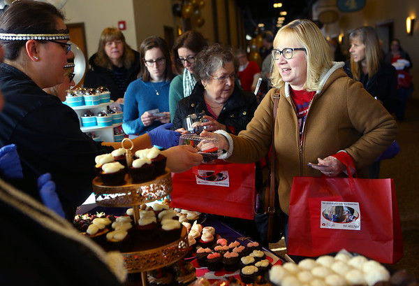 Lori McDaniel gets some sweet treats at the Dreams to Reality Cakes table during the 18th annual Chocolate Celebration, benefiting the Samaritan Caregivers, at Kokomo's First Church of the Nazarene on Friday, Feb. 7, 2020.<br /> Kelly Lafferty Gerber | Kokomo Tribune