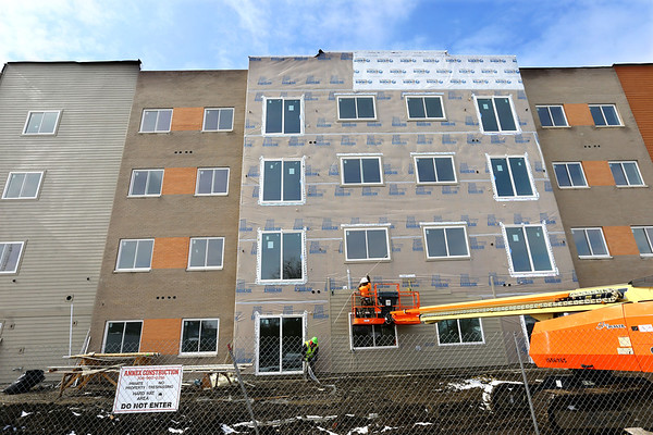 The final section of siding being installed at the Union at Washington Apartments being constructed by Annex Construction on February 27, 2020.<br /> Tim Bath | Kokomo Tribune