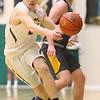 2-18-20<br /> Eastern vs Alexandria boys basketball<br /> Karson West takes the ball down the court.<br /> Kelly Lafferty Gerber   Kokomo Tribune