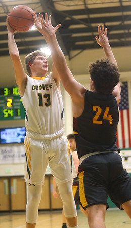 2-18-20<br /> Eastern vs Alexandria boys basketball<br /> Evan Monize puts up a shot.<br /> Kelly Lafferty Gerber | Kokomo Tribune