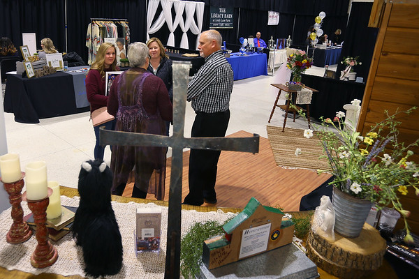 Heritage Farm representatives talk with a future bride at the Heartland Bridal show at the Kokomo Event and Conference Center on February 29, 2020.<br /> Tim Bath | Kokomo Tribune