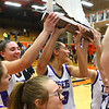 2-22-20<br /> Northwestern vs Penn girls basketball semistate<br /> Kendall Bostic, left, and Madison Layden, center, cheer with their teammates as they hoist the trophy after their semistate win.<br /> Kelly Lafferty Gerber | Kokomo Tribune