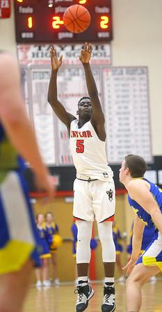 2-28-20<br /> Taylor vs Tri-Central boys basketball<br /> Taylor's Toric Spires puts up a three.<br /> Kelly Lafferty Gerber | Kokomo Tribune