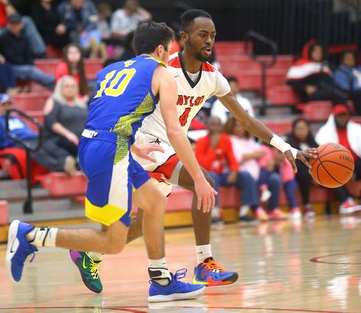 2-28-20<br /> Taylor vs Tri-Central boys basketball<br /> Taylor's Jaylin Reece takes the ball down the court.<br /> Kelly Lafferty Gerber | Kokomo Tribune