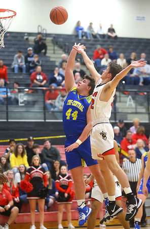 2-28-20<br /> Taylor vs Tri-Central boys basketball<br /> Tri-Central's Conner Hindman puts up a shot over Taylor's Josh Bowman.<br /> Kelly Lafferty Gerber | Kokomo Tribune