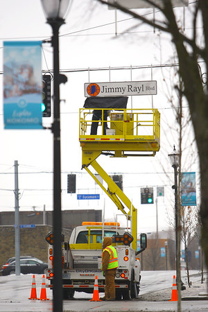 Vaughn Kenyon in the bucket and Bryce Scott from the City of Kokomo Traffic Department unveils the new honorary street signs for Jimmy Rayl Blvd along Superior Street on February 6, 2020.<br /> Tim Bath | Kokomo Tribune