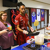 "Sophomore Brailee Millard, left, watches as fellow sophomore Korvyan Davis flips the crepe he's cooking for her at his ""International Food"" table during the Kokomo High School International Baccalaureate Middle Years Program's Personal Project Showcase on Feb. 27, 2020.<br /> Kelly Lafferty Gerber 