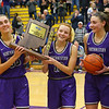 2-15-20<br /> Northwestern vs Homestead girls basketball regional championship<br /> Seniors from left: Kate Miller, Madison Layden, Klair Merrell, Kendall Bostic, and Sarah Heaver carry the regional trophy back to the team after the Tigers win.<br /> Kelly Lafferty Gerber | Kokomo Tribune