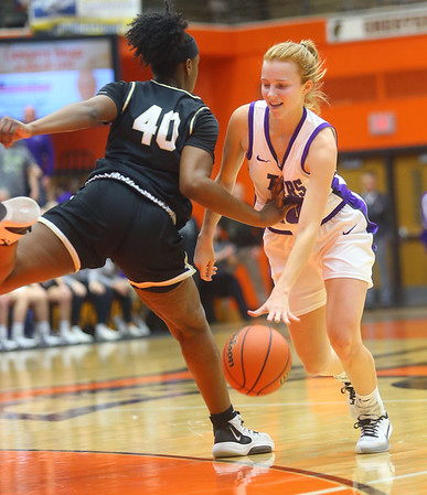 2-22-20<br /> Northwestern vs Penn girls basketball semistate<br /> NW's Klair Merrell heads to the basket as she tries to get around Penn's Jada Patton.<br /> Kelly Lafferty Gerber | Kokomo Tribune