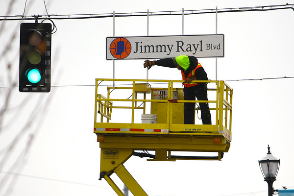 Vaughn Kenyon from the City of Kokomo Traffic Department unveils the new honorary street signs for Jimmy Rayl Blvd along Superior Street on February 6, 2020.<br /> Tim Bath | Kokomo Tribune