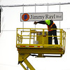 Vaughn Kenyon from the City of Kokomo Traffic Department unveils the new honorary street signs for Jimmy Rayl Blvd along Superior Street on February 6, 2020.<br /> Tim Bath   Kokomo Tribune