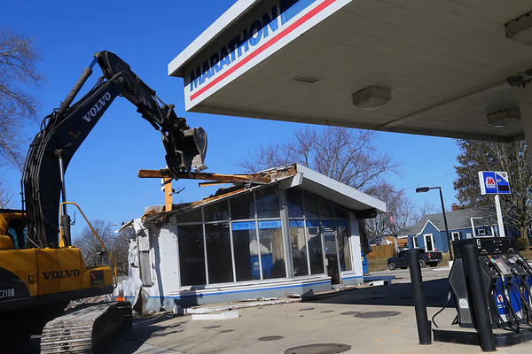 Cory Brust from Von Excavating takes down the old Southside Marathon building at Boulevard and Washington on February 19, 2020. Good Oil Company, which bought the business that had been open since 1956, plans to construct either a Marathon or BP station alongside a convenience store.<br /> Tim Bath | Kokomo Tribune