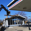 Cory Brust from Von Excavating takes down the old Southside Marathon building at Boulevard and Washington on February 19, 2020. Good Oil Company, which bought the business that had been open since 1956, plans to construct either a Marathon or BP station alongside a convenience store.<br /> Tim Bath   Kokomo Tribune
