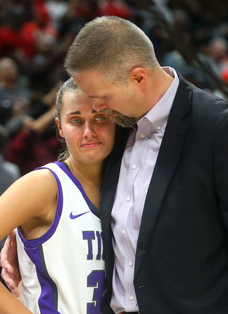 2-29-20<br /> Northwestern vs Lawrence North girls basketball state finals<br /> Jeff Layden hugs his daughter Madison Layden after Northwestern falls to Lawrence North 59-56.<br /> Kelly Lafferty Gerber | Kokomo Tribune
