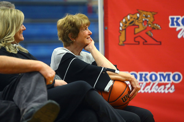"""Nancy Rayl, wife of the late Jimmy Rayl, listens to former basketball teammates, coaches, friends and family speak about her husband and Indiana basketball legend during a special ceremony inside Memorial Gym on Thursday, Feb. 6, when the City of Kokomo announced the honorary renaming of West Superior Street leading to Memorial Gym """"Jimmy Rayl Boulevard.""""<br /> Kelly Lafferty Gerber   Kokomo Tribune"""