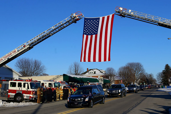 Funeral for Jeff Stout with the procession through Russiaville past Stout and Sons Funeral Home and Russiaville Fire Depatment on February 14, 2020.<br /> Tim Bath | Kokomo Tribune