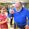 Breanna Degraffenreid, 12, gives Richard Phillabaum a sample of their rice to taste-test before plating it and serving it to the judges during the Chopped competition on Tuesday, Feb. 18, 2020. Western Middle School FACS club students and Waterford Place residents teamed up to prepare and cook a dish using certain ingredients in 45 minutes.<br /> Kelly Lafferty Gerber | Kokomo Tribune