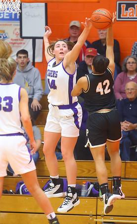 2-22-20<br /> Northwestern vs Penn girls basketball semistate<br /> NW's Kendall Bostic blocks the shot of Penn's Trinity Clinton.<br /> Kelly Lafferty Gerber | Kokomo Tribune
